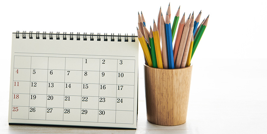 flip calendar with a pot of colouring pencils