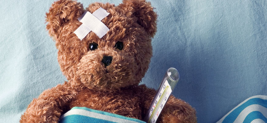 teddy bear with bandage and thermometer